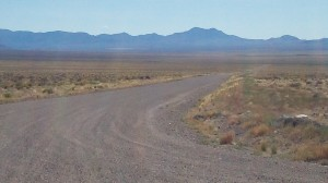Yess, follow this non-descript dirt road a mere 10 miles to the other side of those mountains, and there you find the Area 51 Boundary. We decided that for us--on bicycles--this view from the highway was enough.